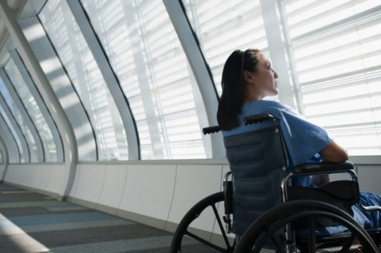 Patient in wheelchair looking out window