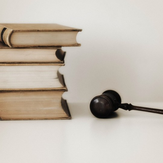 Judges gavel beside stacked law books